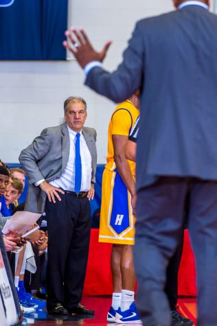 Hofstra head coach Joe Mihalich stares at a referee while FAU head coach Michael Curry argues an out-of-bounds call.