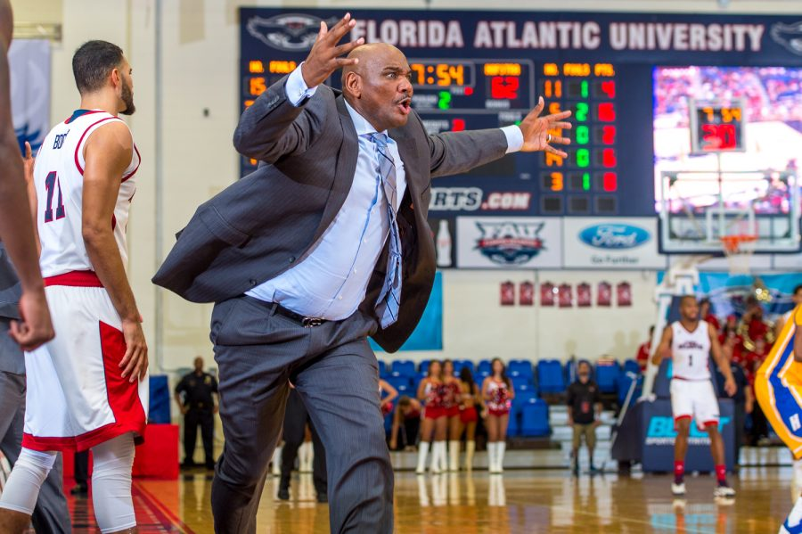 FAU head coach Michael Curry throws up his hands after a missed breakaway dunk by Jailyn Ingram (15) with Hofstra trailing by one point.