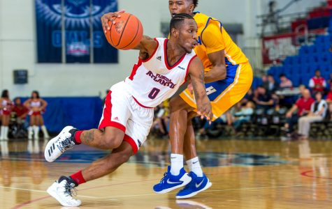 Adonis Filer (0) dribbles around a Hofstra guard on his way to the basket.