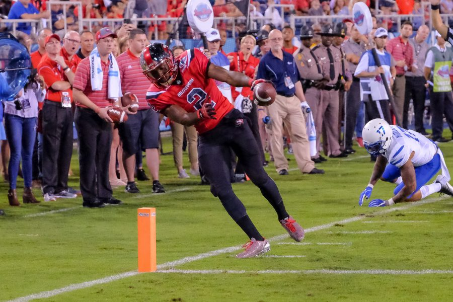 Western Kentucky senior wide receiver Taywan Taylor (2) runs 41 yards past two defenders for a touchdown. Mohammed F Emran | Staff Photographer
