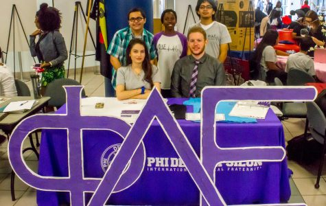 Phi Delta Epsilon member Jonathan Freeman (front right), Mandy Jatcia (front left), Akeal Sheikh (back left), Efrain Aguaya Mallon (back right) and Saishay Robinson recruit new members in the student union during the first week of the semester. Brendan Feeney | Managing Editor