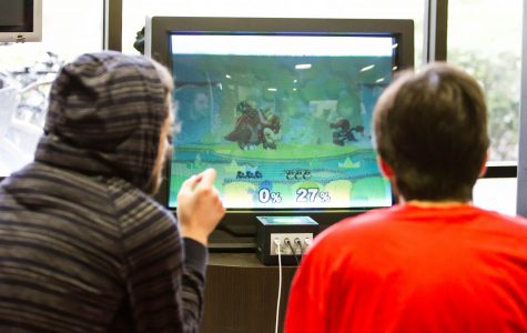 Graduate of Palm Beach State College Garen Mazmanian (left) competes with another player in Super Smash Bros. inside the Student Union. Alexander Rodriguez | Contributing Photographer