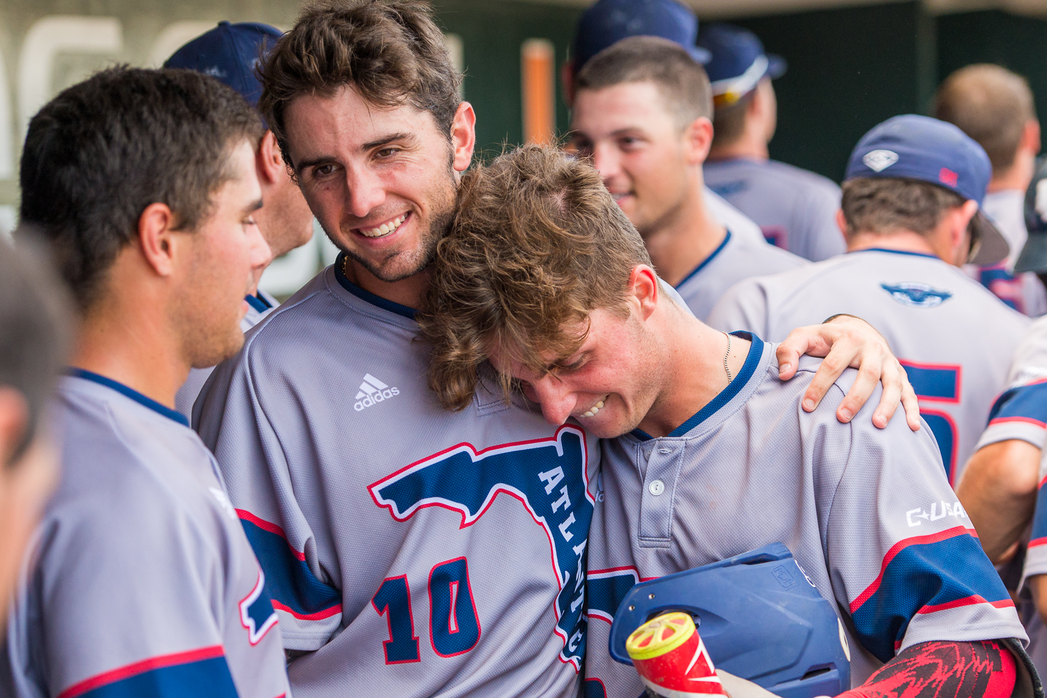 CJ Chatham (10) embraces Tyler Frank following Frank's first ever collegiate home run in last year's NCAA Miami regional. Photo by Max Jackson