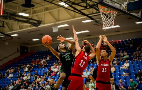 North Texas freshman A.J. Lawson goes up for a layup over FAU juniors Frank Booker (11) and Ronald Delph during the Owls' 70-64 loss Thursday. Alexander Rodriguez | Contributing Photographer