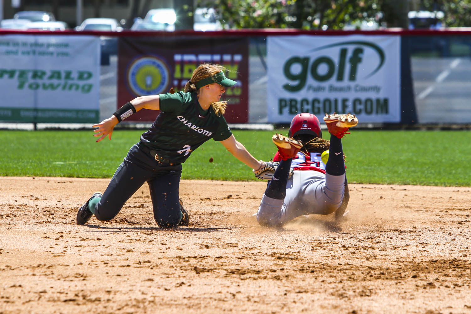 Junior Emily Lochten (25) slides safely into second base against Charlotte. Alexander Rodriguez | Contributing Photographer