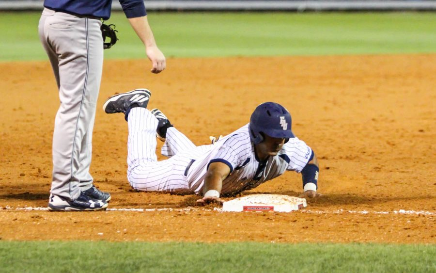 Redshirt junior Kevin Abraham slides into third base during the Owls 16-5 win versus Monmouth on February 17.