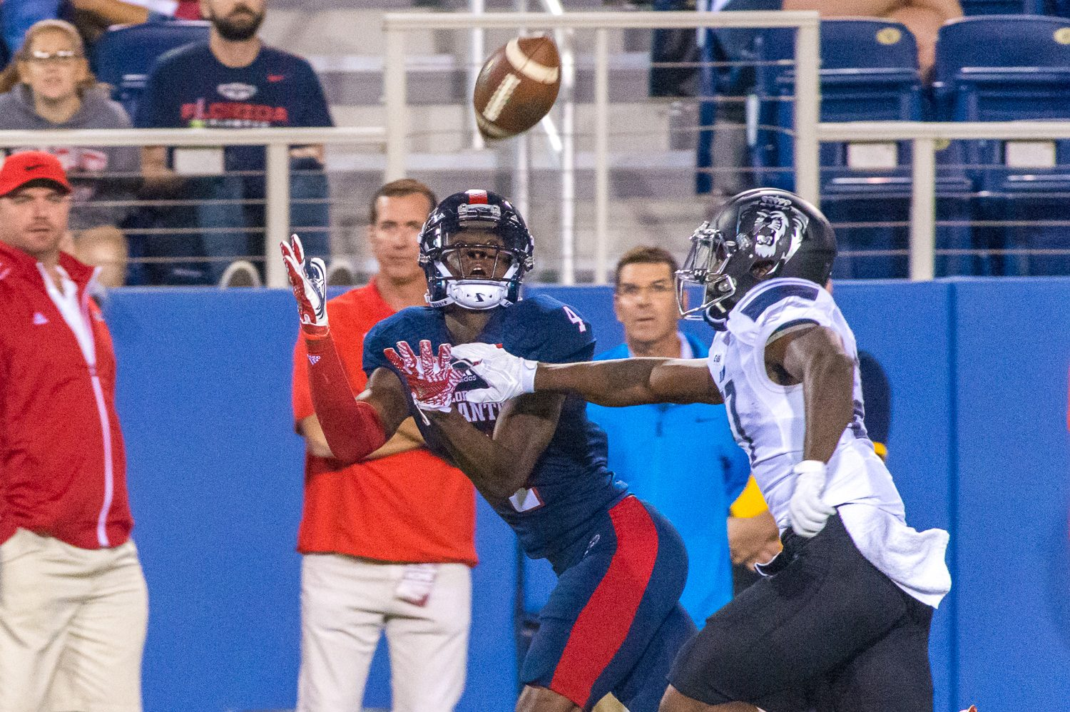Owls wide receiver Kalib Woods (4) reaches to catch a 38-yard pass from quarterback Jason Driskel (16)during the Owls game against Old Dominion on November 19, 2016. Photo by Max Jackson