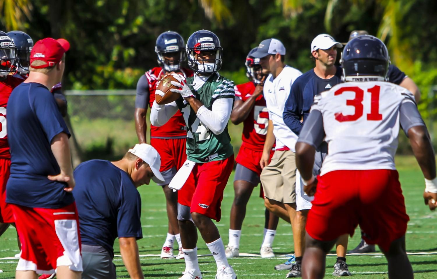 FAU quarterback De'Andre Johnson (14) prepares to throw a ball to his teammate during practice play. Alex Rodriguez | Photo Editor