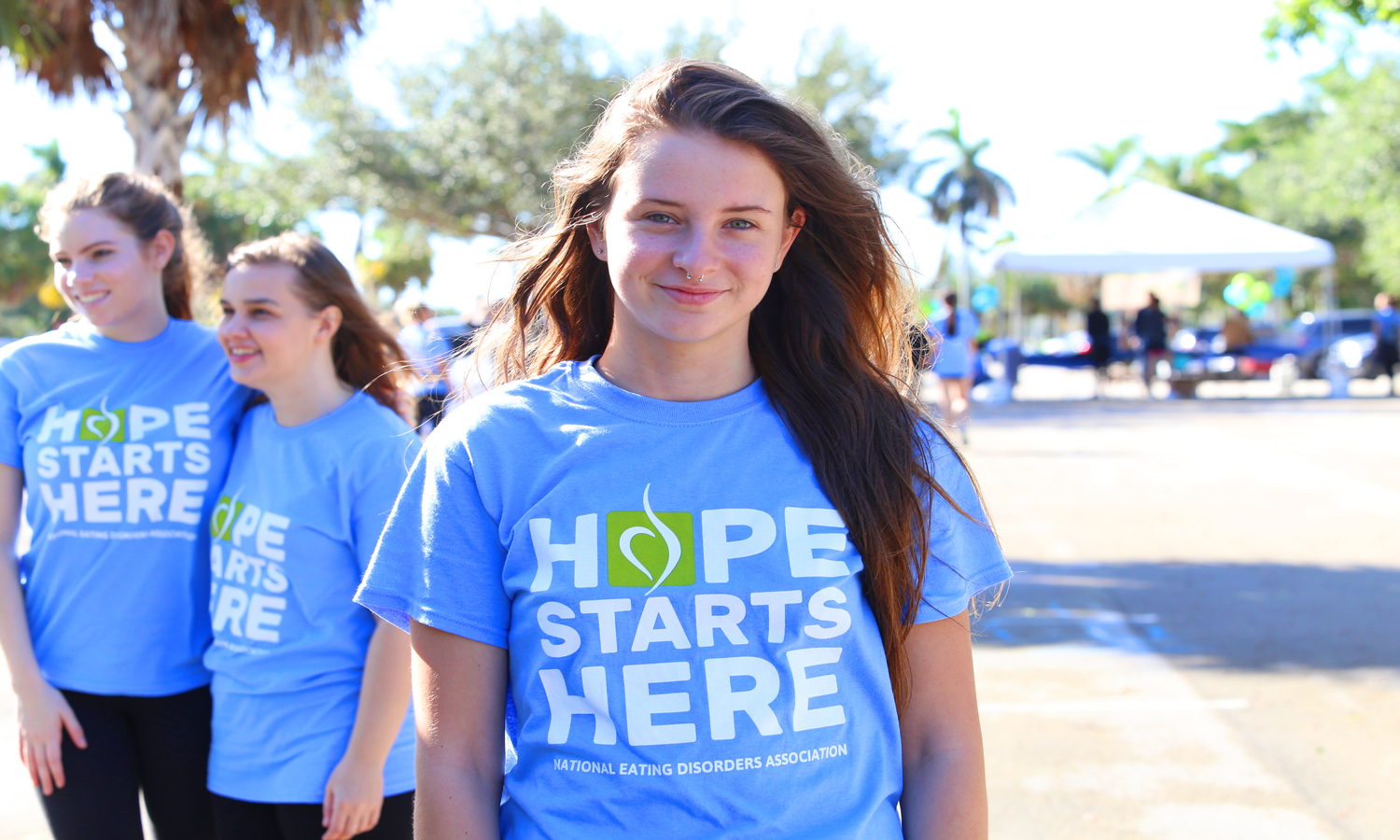 "Ali Dusinberre, high school senior and Vice President of Eating Disorder Awareness Club at Spanish River High School, poses for a picture after walking the NEDA walk while wearing a shirt that says ""Hope Starts Here.""  Alexander Rodriguez 