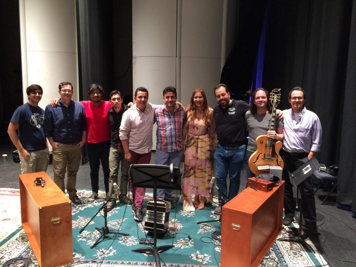Members of the production team pose with the Quinteto Leopoldo Federico ensemble and guest artist María Isabel Saavedra after the final recording session. From left to right: commercial music major Joel Iglesias, assistant professor and recording/mastering engineer on the album Matt Baltrucki, violin player Daniel Plazas, bass player Kike Harker, bandoneon and musical director Giovanni Parra, guest artist María Isabel Saavedra, associate professor, album producer/engineer Alejandro Sánchez-Samper, guitar player Kike Harker, Iván Beltrán, who has a masters in music. Photo courtesy of Hoot/Wisdom Recordings