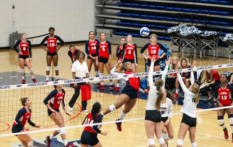 Junior rightside hitter Abbi Reid (10) spikes the ball past the North Texas's defense and obtains a point for FAU during their Oct. 15 game versus North Texas. Lauren Sopourn | Contributing Writer
