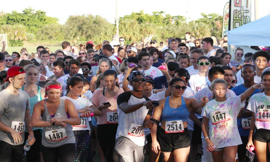Runners wait at the starting line Sunday afternoon. Matthew Quick | Contributing Writer