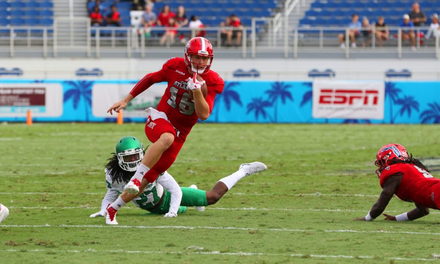 Redshirt Junior quarterback Jason Driskel runs toward the open field on a rush play in the first half of FAU's 69-31 win over North Texas on Oct. 21. Driskel ran for 66 yards and touchdown during the game. Joshua Giron | Contributing Photographer