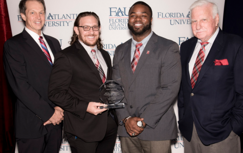 (Left to right) President John Kelly, former football players Kris Bartels and Cergile Sincere, head coach Howard Schnellenberger. Photo courtesy of Jeffrey Tholl Photography