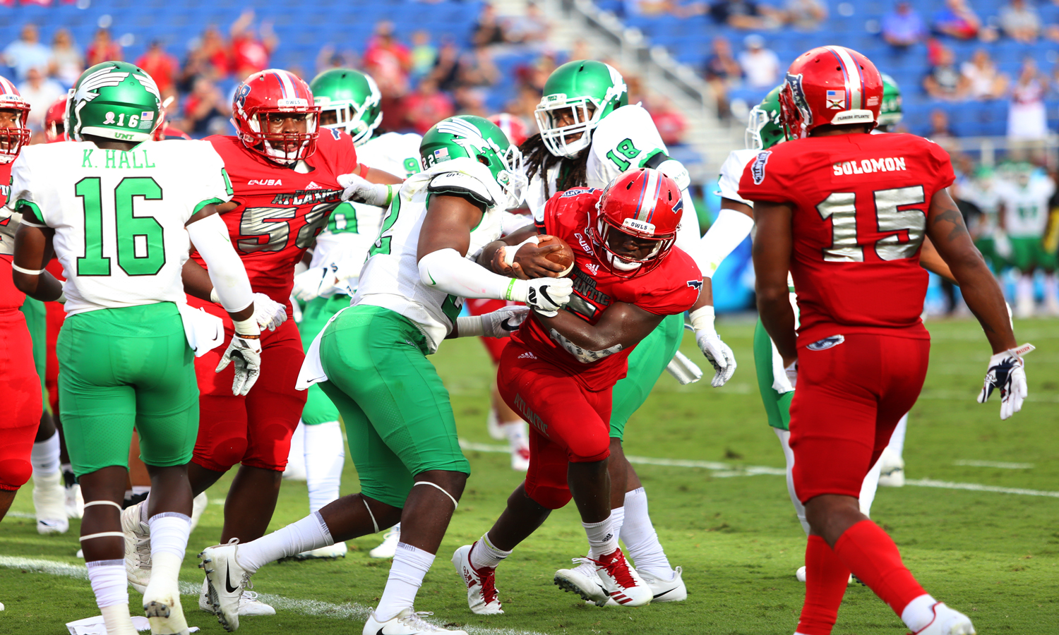 FAU sophomore running back Devin Singletary (5) gets tackled by North Texas redshirt junior linebacker E.J. Ejiya (22). FAU went on to win against North Texas 69-31 on Saturday.  Alexander Rodriguez | Photo Editor