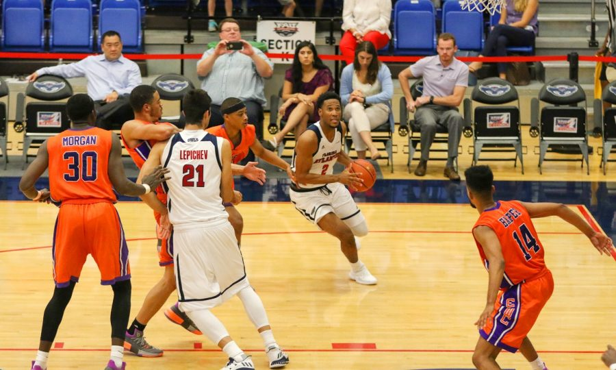 FAU+senior+guard+Justin+Massey+%282%29+dribbles+the+ball+toward+the+hoop+and+scores+a+layup+during+the+first+half+of+the+Owls%E2%80%99+game+against+Edward+Waters+on+Nov.+15.+Joshua+Giron+%7C+Staff+Photographer+