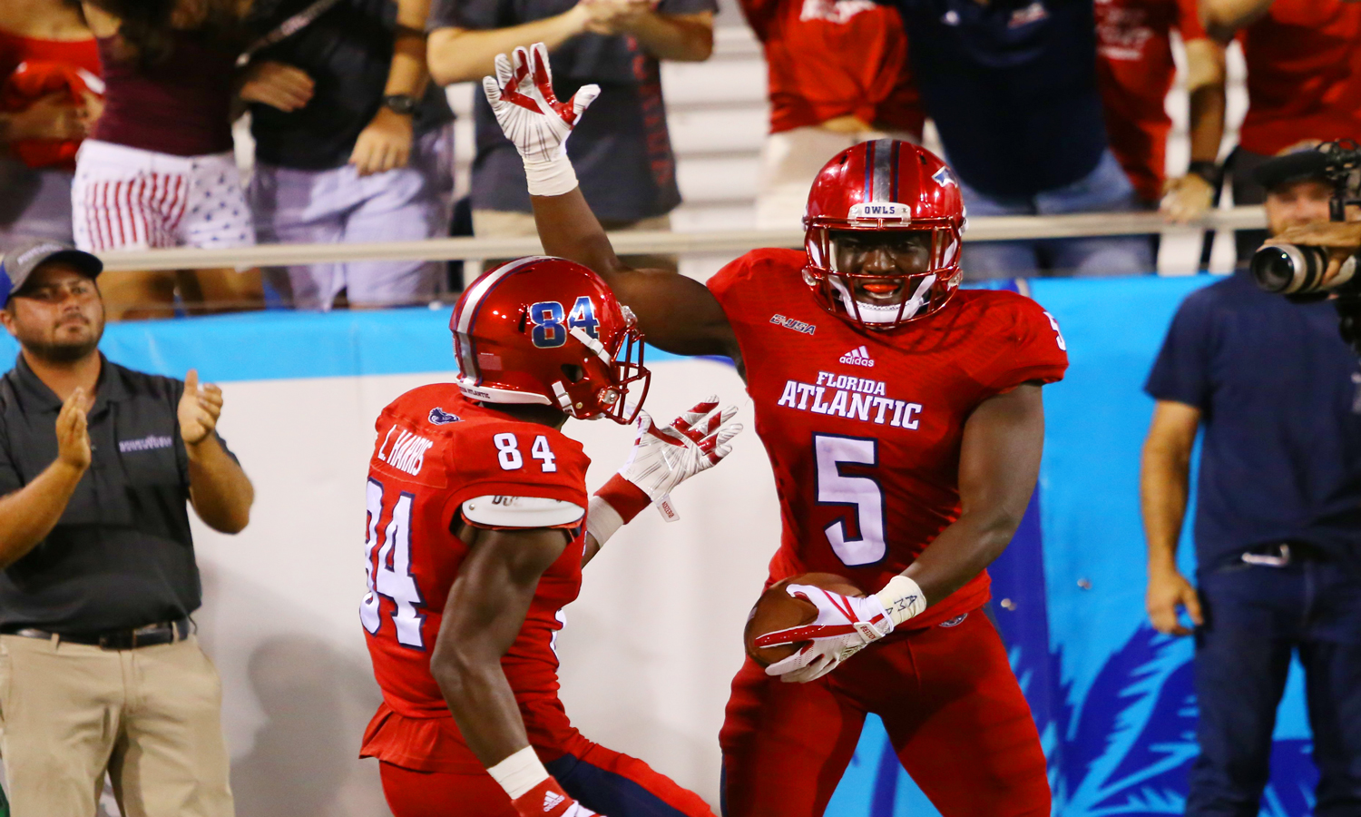 FAU sophomore running back Devin Singletary (5) celebrates with redshirt sophomore wide receiver LaDante Harris after scoring a touchdown for the Owls during the third quarter versus Marshall. Alexander Rodriguez | Photo Editor