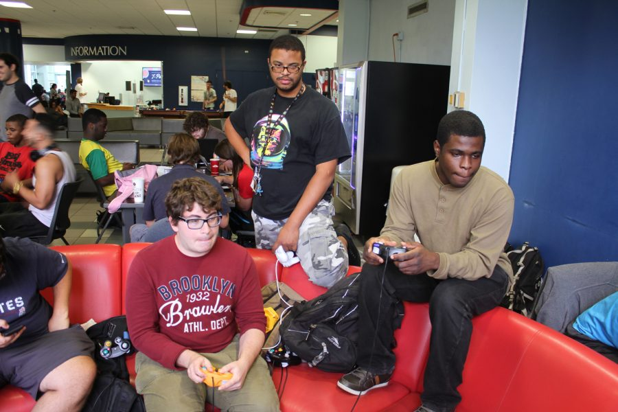 Students+practice+their+Super+Smash+Bros.+skills+in+the+Student+Union.+Thomas+Chiles+%7C+Features+Editor