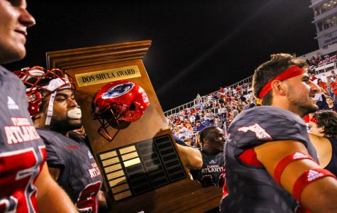 FAU football players carry the Don Shula Award back into the locker rooms after celebrating with fans on the field. Alexander Rodriguez | Photo Editor
