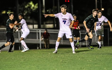 Freshman defender Ferdinand Solberg (7) directs his teammates on who to cover during FAU's Oct. 14 match against Charlotte. Lauren Sopourn | Contributing Writer