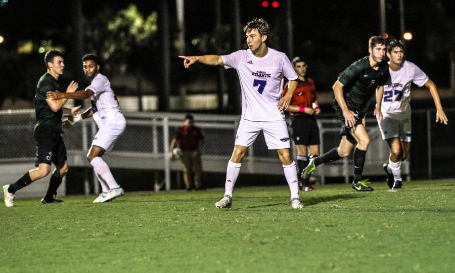 Freshman+defender+Ferdinand+Solberg+%287%29+directs+his+teammates+on+who+to+cover+during+FAU%E2%80%99s+Oct.+14+match+against+Charlotte.+Lauren+Sopourn+%7C+Contributing+Writer
