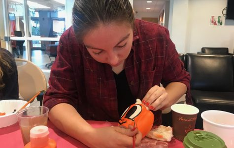 Desiree Cancel, a junior majoring in psychology, paints a pumpkin at Owlcraft. Thomas Chiles | Features Editor