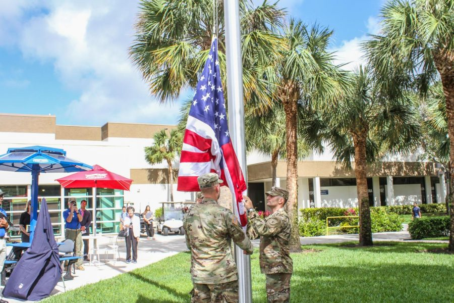 US Army Soldier Ronald Fulmore (left) and US Army Soldier Paul Roderick (right) help set up the US flag and raise the flag during the Florida Atlantic University Veterans' Flagpole Ceremony on Tuesday afternoon. Alexander Rodriguez | Photo Editor