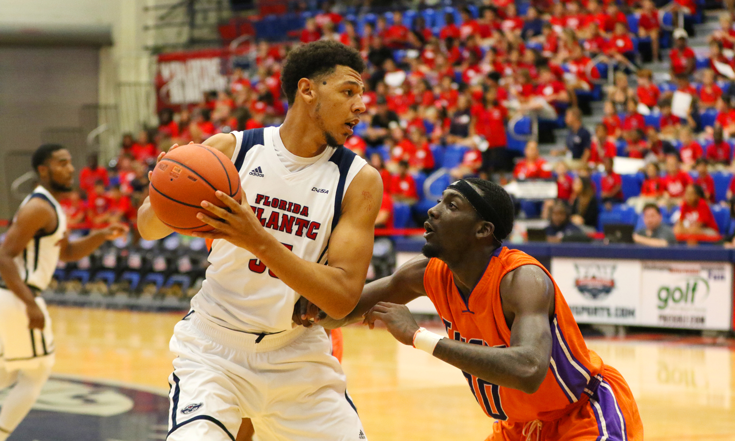 FAU redshirt senior center Ronald Delph (33) looks around for a pass while being guarded by a Edward Waters player during the Owls Nov. 16 game versus the Tigers. Joshua Giron | Staff Photographer