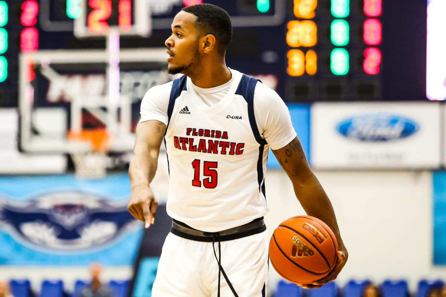 FAU sophomore forward Jailyn Ingram (15) calls out for a teammate to come toward him before passing the ball. FAU went on to win against Webber International University 108-46 on Sunday afternoon. Alexander Rodriguez | Photo Editor