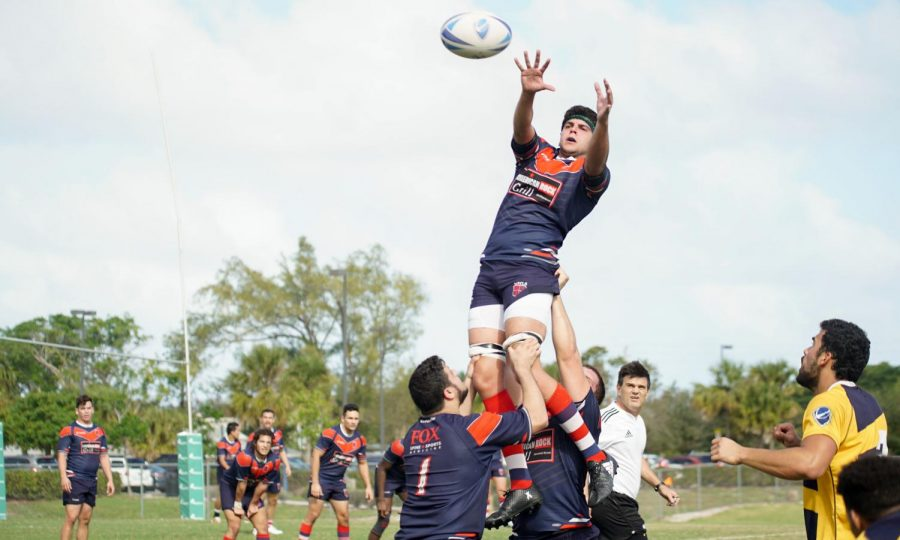 Jumper Cody Cito reaches for the ball in this line-out against FIU on Saturday.Maurice Moran | Contributing Photographer