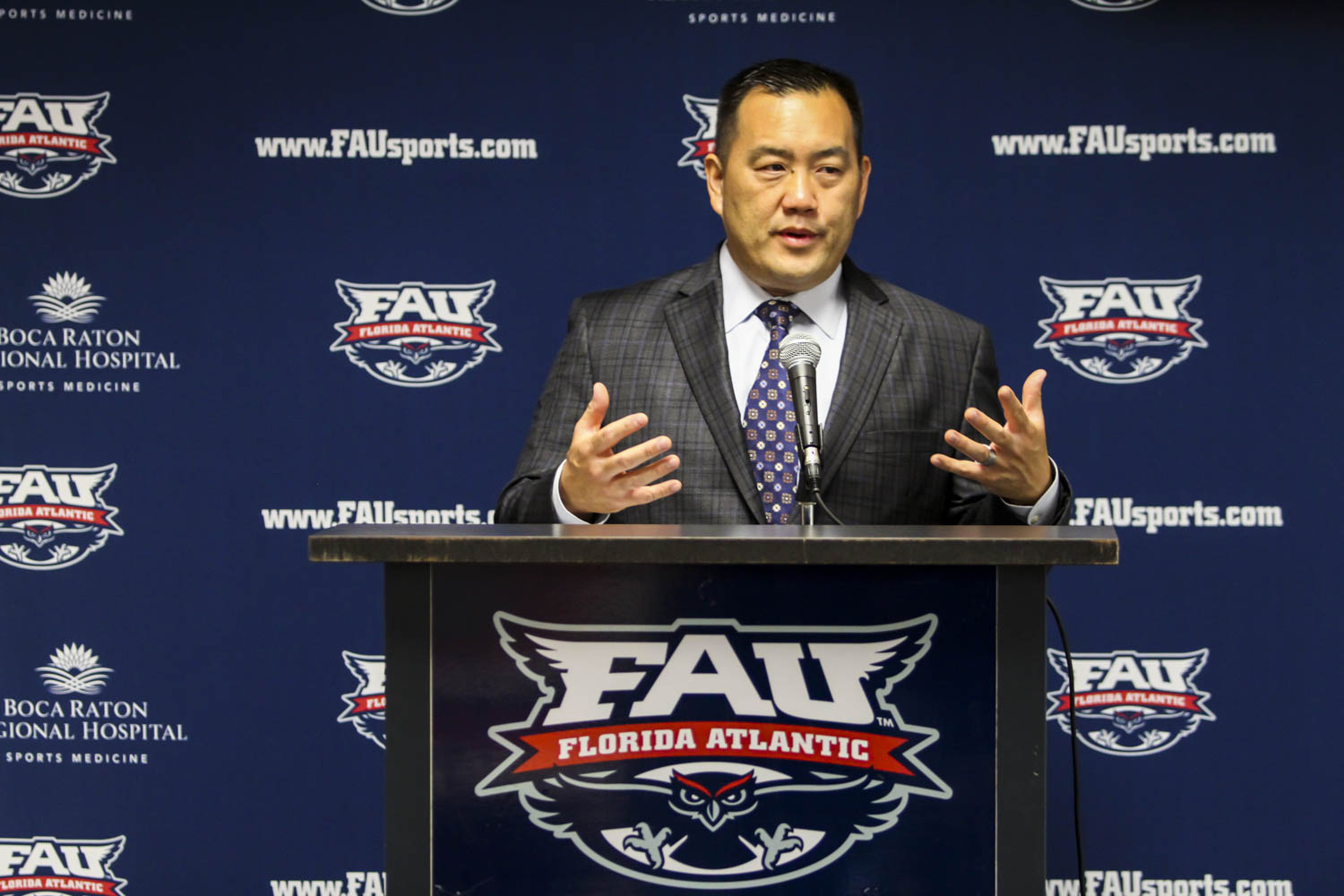 FAU athletic director  Patrick Chun introduces women's basketball head coach Jim Jabir during a press conference on April 6, 2017. Alexander Rodriguez | Senior Photographer