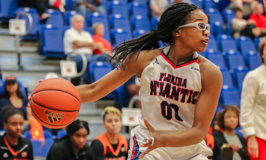 FAU redshirt junior guard Danneal Ford (00) looks up the court to find a pass to her players. FAU went on to lose 66-55 against Mercer on Nov 17, 2017. Lauren Sopourn | Contributing Writer