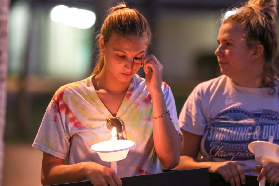 A student wipes away a tear during a Parkland shooting vigil held on the Boca campus March 16. Joshua Giron | Photo Editor