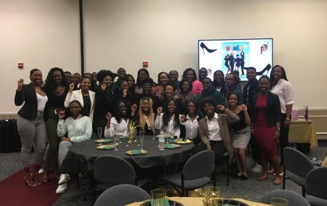 The FAU chapter of the National Council of Negro Women pose with panel members. Destiny Harris | Contributing Writer