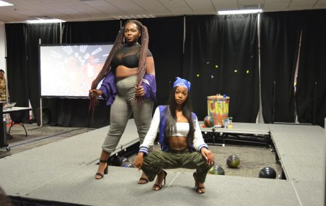 """Student models pose in their outfits inspired by various themes of the 90s including: street wear, men of the 90's, hip-hop culture, and the television show """"All That."""" Violet Castano 