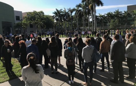 Students gathered on the Boca campus Free Speech Lawn Wednesday morning to honor the Parkland shooting victims one month later. Hope Dean | Features Editor
