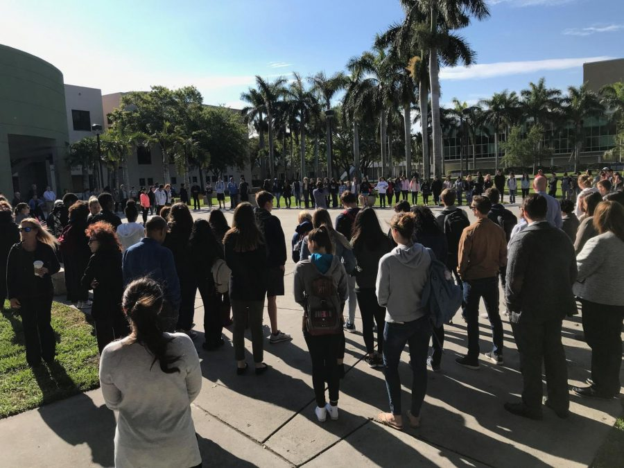 Students+gathered+on+the+Boca+campus+Free+Speech+Lawn+Wednesday+morning+to+honor+the+Parkland+shooting+victims+one+month+later.+Hope+Dean+%7C+Features+Editor+