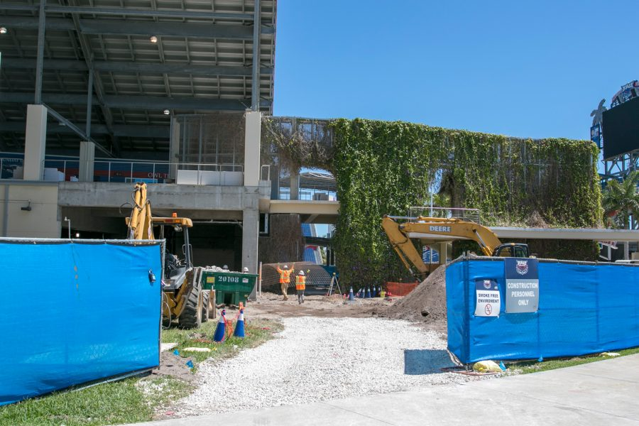 Construction workers stand on the future site of the Schmidt Family Complex near the FAU Stadium. Joshua Giron | Photo Editor