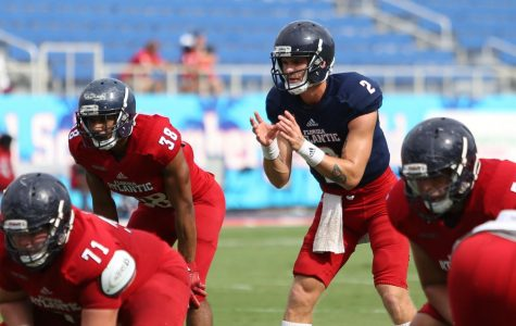 FAU redshirt freshman quarterback Chris Robison (2) waits for the ball to be passed during the second half.  Alex Rodriguez | News Editor
