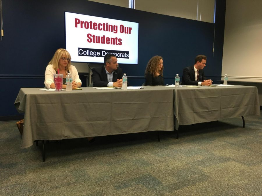 (Left to right) Boca Councilwoman Monica Mayotte, uncle of a Stoneman Douglas student who was killed Luke Sherlock, freshman at Stoneman Douglas Eva Frost, and candidate for Florida State House District 89 Ryan Rossi. They were panelist for a gun reform discussion at the Student Union. Destiny Harris | Contributing Writer