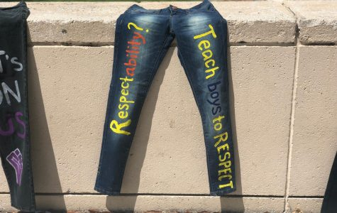 A pair of painted jeans reading