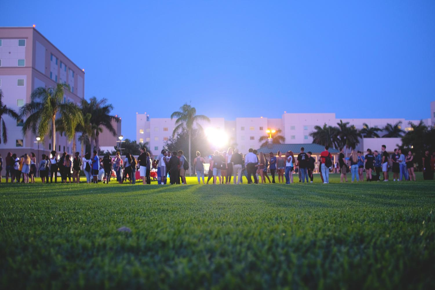 Students lined up for food trucks during the Glowfest party. Violet Castano | Photo Editor