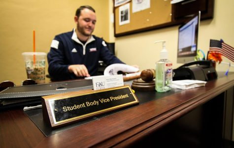 VP-elect Kyle MacDonald sits at his desk in the Student Government offices. He has taken over as temporary student body president. Photo by Alexander Rodriguez