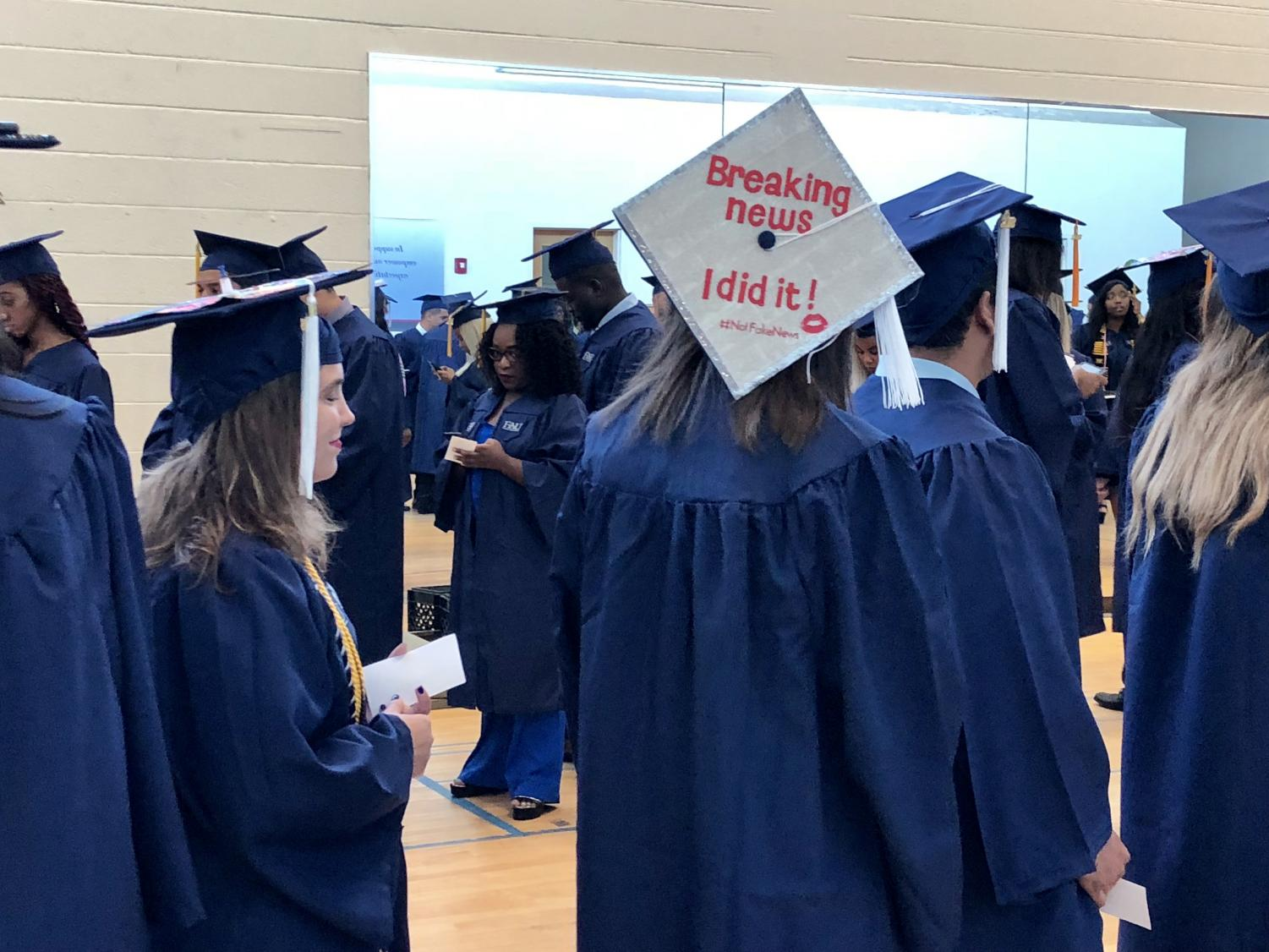261 students wait to graduate in the Basketball Arena.