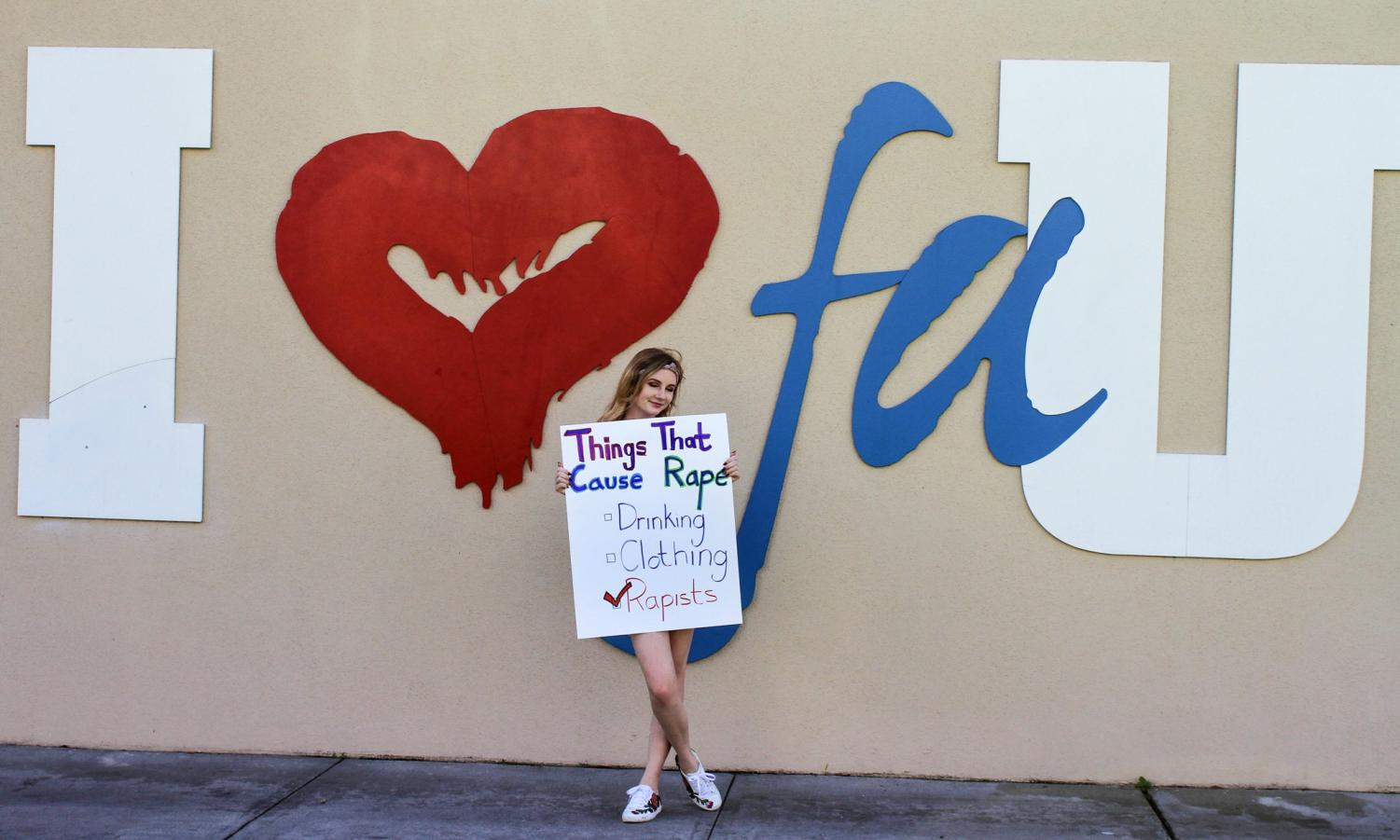 FAU freshman and business major April McPherson holds a sign during the spring 2018 Slut Walk, an event promoting consent and body positivity. The message on her sign is a core belief of Flip the Script — a scientifically proven sexual assault prevention course only available at FAU in the U.S. Photo by Violet Castano