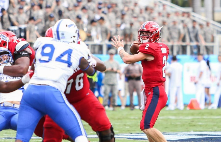 FAU+redshirt+freshman+quarterback+Chris+Robison+%282%29+decides+where+to+throw+the+football+before+being+tackled+by+the+Air+Force+defense.+Photo+by+Alexander+Rodriguez