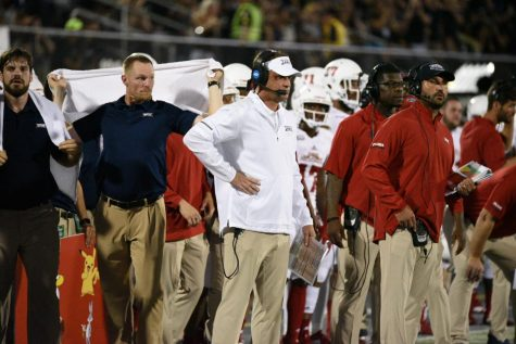 FAU head coach Lane Kiffin awaits on the sideline after a call was made against FAU. Photo by Pierce Herrmann