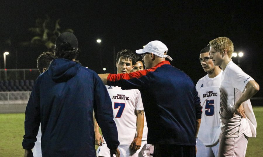 FAU+head+coach+Joey+Worthen+and+FAU+assistant+coach+Jose+Robles+give+guidance+to+players+during+the+soccer+match+against+Jacksonville.+Photo+by+Lauren+Sopourn
