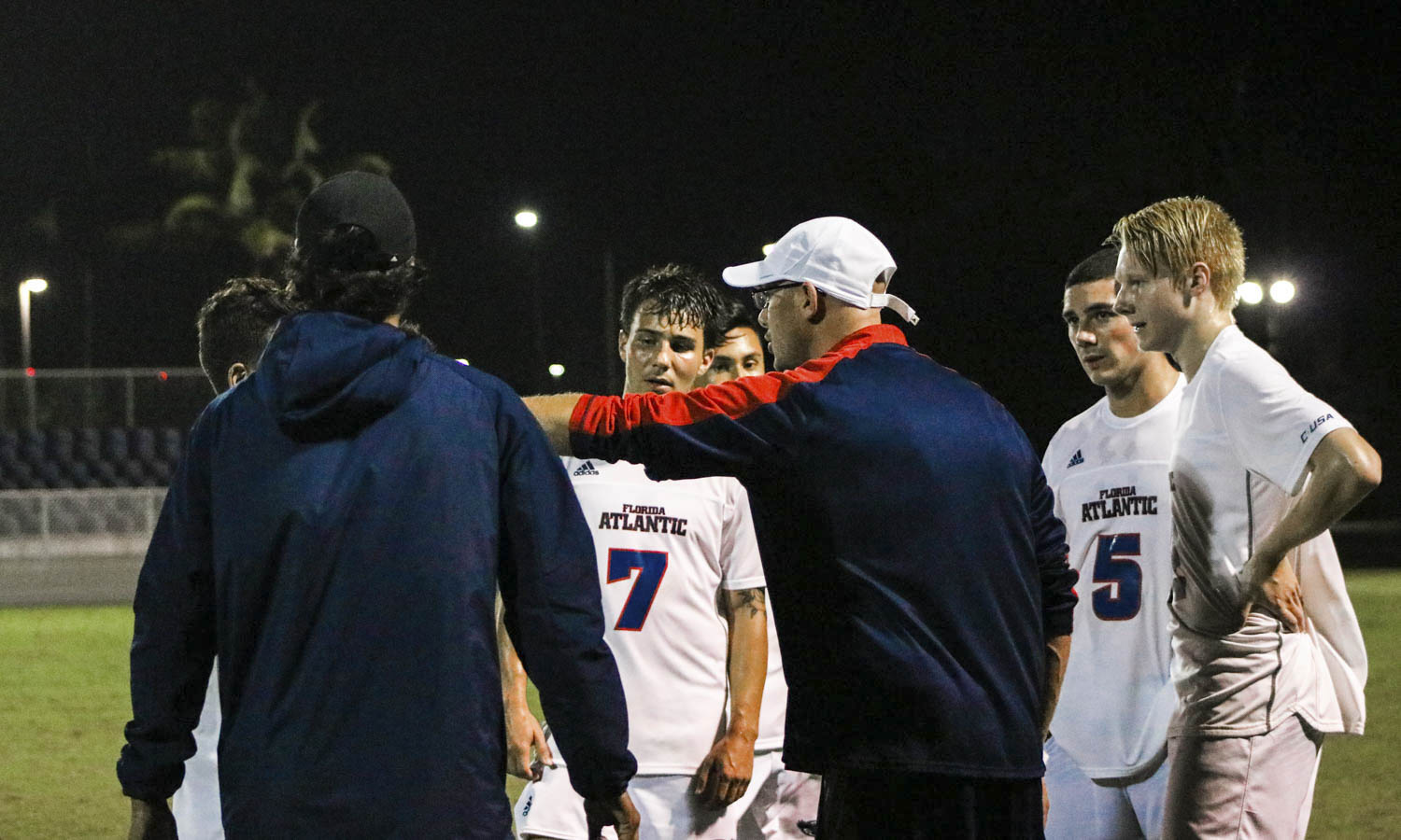 FAU head coach Joey Worthen and FAU assistant coach Jose Robles give guidance to players during the soccer match against Jacksonville. Photo by Lauren Sopourn