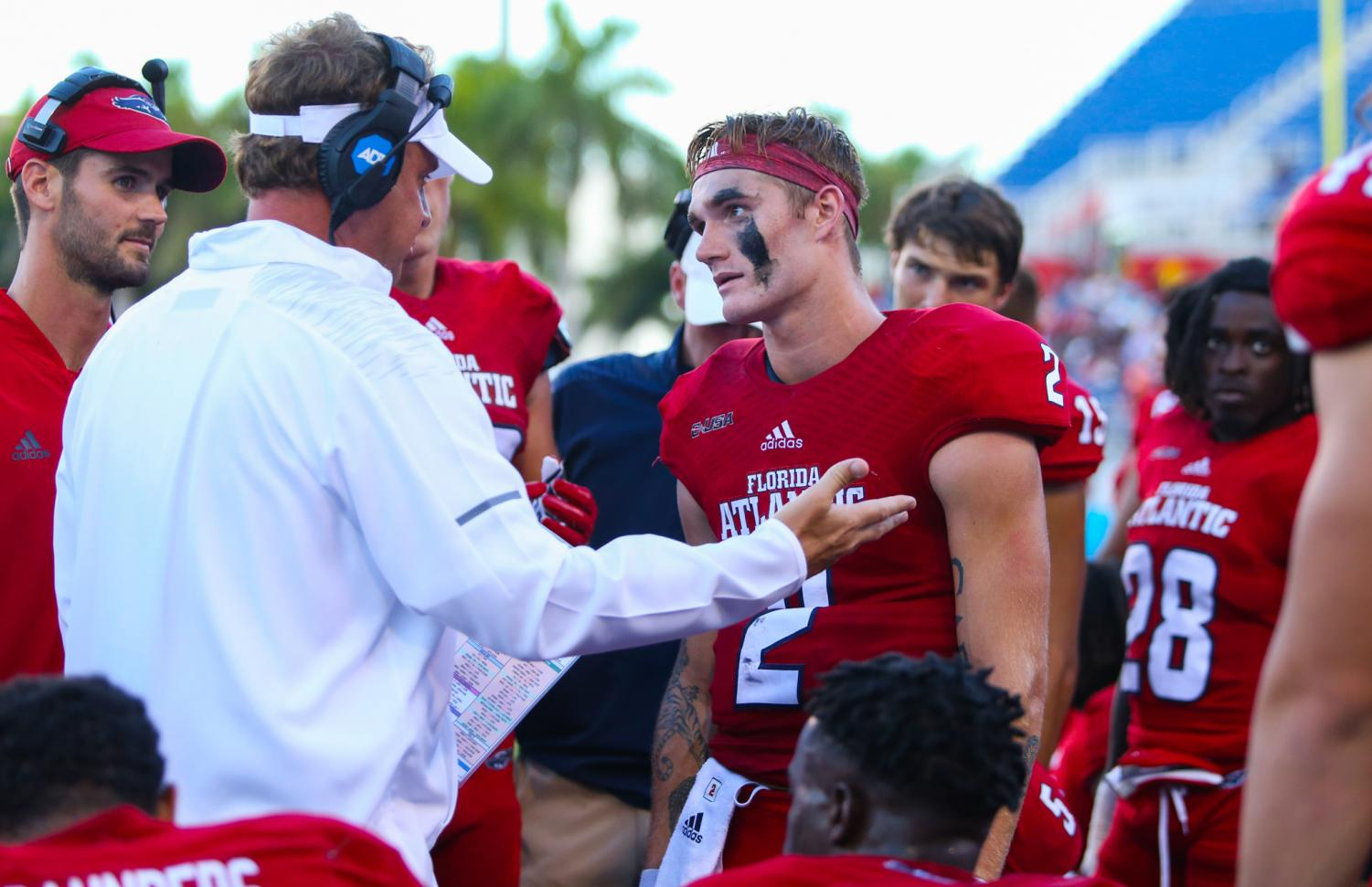 FAU quarterback Chris Robison (2) and FAU head coach Lane Kiffin have a minor discussion after the first quarter was over against Bethune Cookman. Photo by: Alexander Rodriguez